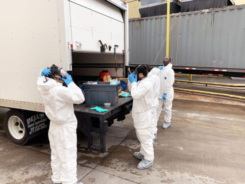 Donning Level C PPE for fogging a food manufacturing plant